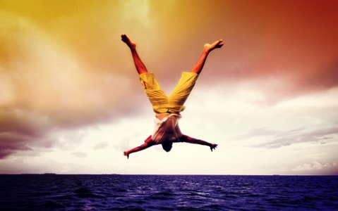 man_diving_into_sea colourised