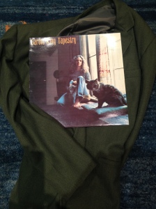 Carole King tapestry record on a green jacket
