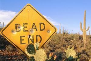 end road sign in desert