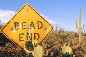 end road sign in desert