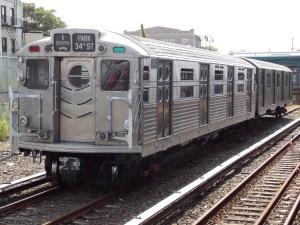 R11-R34_8013_at_Rockaway_Park_-_Beach_116th_Street_Station subway train