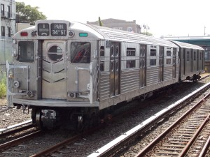 R11-R34_8013_at_Rockaway_Park_-_Beach_116th_Street_Station subway train