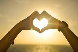 love heart hands at sunset