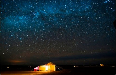 sleeping under the stars tent night sky