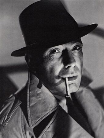 humphrey Bogart actor cigarette hat mackintosh